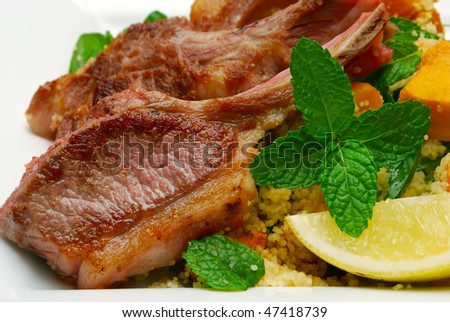 close up of lamb chops with mint