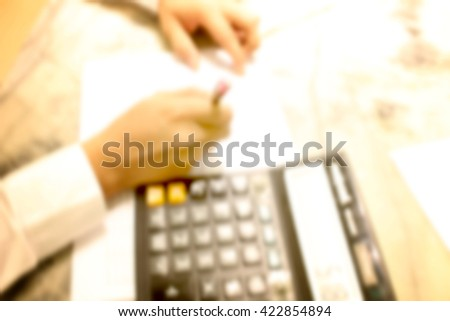 Close up of man with calculator counting - stock photo