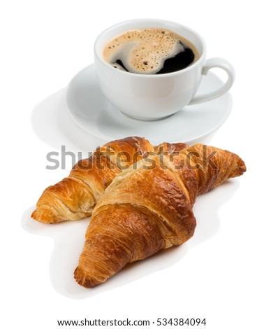 Close up of two croissants and cup of coffee isolated on white background