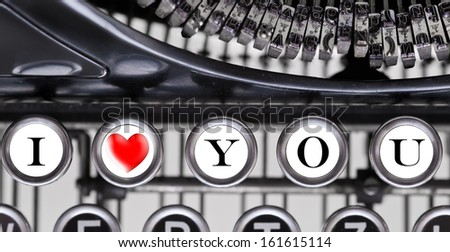 Close up of vintage typewriter keys with text: I love you. - stock photo