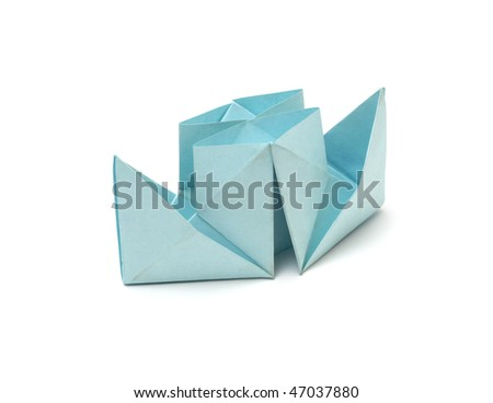 Close up origami ship isolated on white background