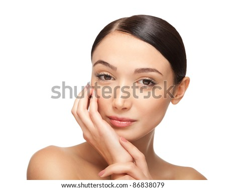 Close up portrait of a beautiful female  model. ?olding hands around the face