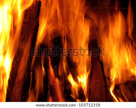 close up shot of fireplace and fire flame - stock photo