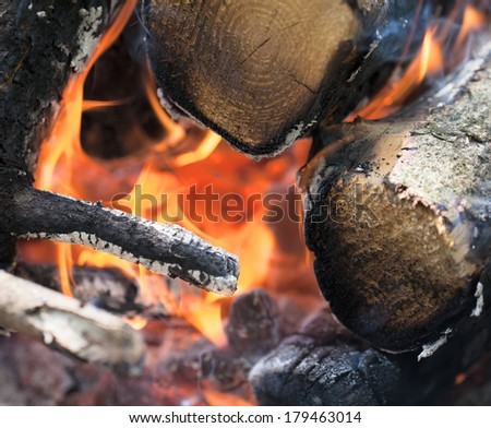Closeup flame on burning wood in fireplace. - stock photo