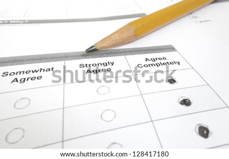 Closeup of a customer or employee survey with Agree Completely filled in - stock photo