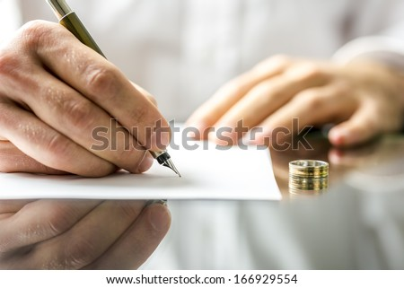 Closeup of a man signing  divorce papers.  - stock photo