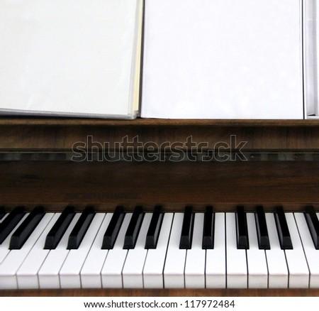Closeup of a old piano keyboard - stock photo