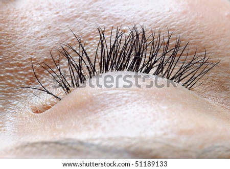 closeup of female closed eye - stock photo