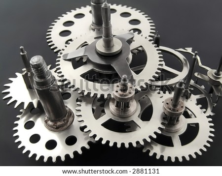 Closeup of gears from clock works. - stock photo