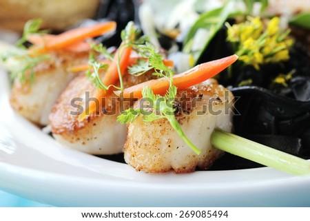 closeup of seared scallops, - stock photo