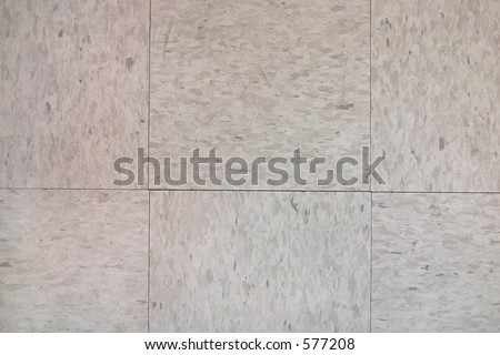 Closeup of tiled linoleum floor. Excellent as background for websites or as texture. - stock photo