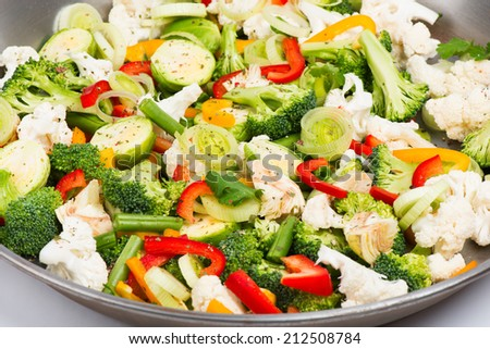 Closeup photo of chopped red  peppers, , broccoli, brussels, cauliflower, onion, artichoke, bean.  - stock photo