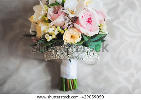 closeup tiara bride with a bouquet of colorful flowers roses
