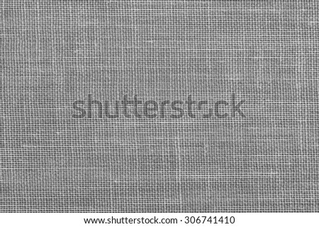 Closeup view of vintage cloth fragment with heavy pattern and textured weave in tones of black, white, and gray/grey. - stock photo