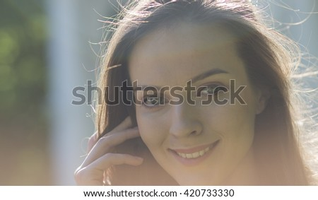 closeup young girl with brown hair