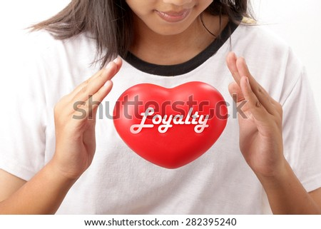 Closeup Young woman hands take care red heart loyalty.  - stock photo