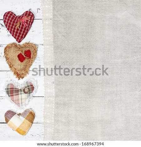 cloth handmade hearts on wooden background. Valentines day - stock photo