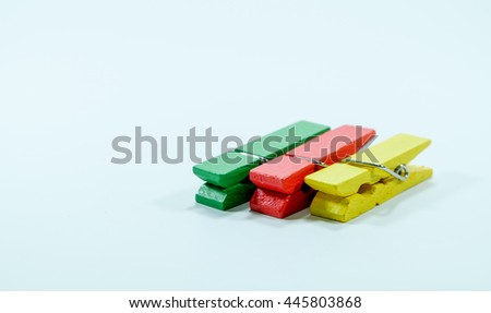 Clothespin three color on white background. - stock photo