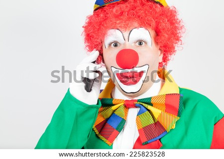 clown with smartphone - stock photo