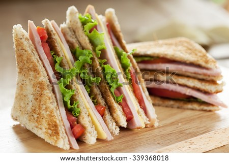 club sandwich on wooden board