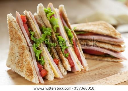 club sandwich on wooden board - stock photo