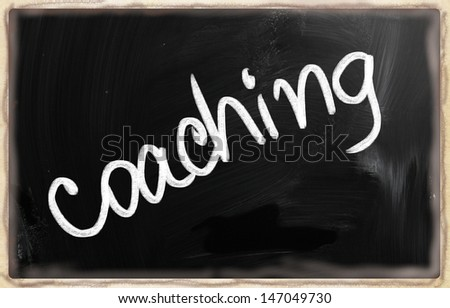 """Coaching"" handwritten with chalk on a blackboard. - stock photo"