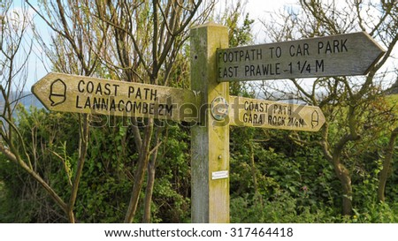 """Coast Path Lannacombe, 2m, Gara Rock 2 1/2 m, Footpath to Car Park, East Prawle 1 1/4"" Signpost on the South West Coastal Path in Devon England, UK - stock photo"