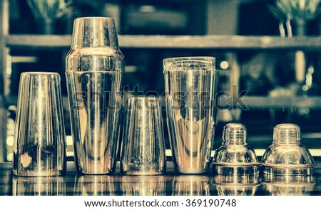 cocktail shaker, bartender tools, a set of equipment, bar, retro style, vintage, black and white photo toning  - stock photo