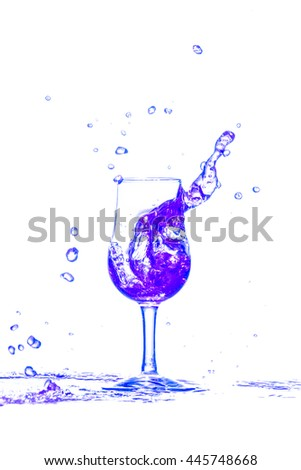 cocktail splash out of glass on white background. - stock photo