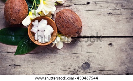 Coconuts,  coconut oil  on  vintage wooden background. Selective focus.  Natural organic spa products. Place for text. Flat lay.
