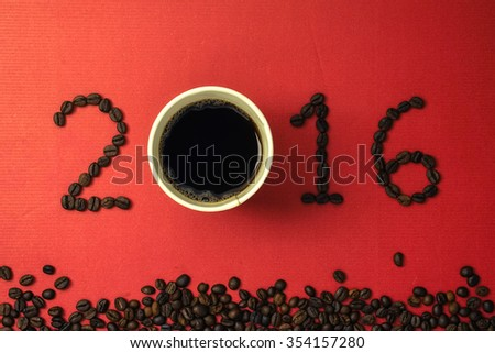 2016 coffee beans on paper texture in vintage style for new year concept - stock photo