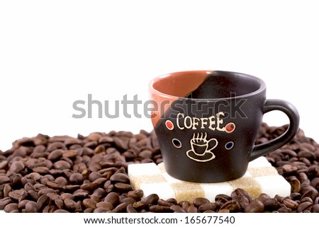Coffee cup and coffee beans isolated on white - stock photo