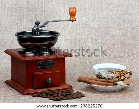 coffee mill coffee in a golden cup, winterly spices - stock photo