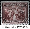 COLOMBIA - CIRCA 1940s: A stamp printed in Colombia shows coffee harvesting, circa 1940s - stock photo