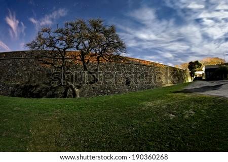 Colonia del Sacramento, Uruguay. The historic quarter is an UNESCO World Heritage Site.  Fortress Wall night view - stock photo