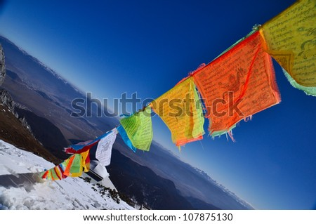 5 color flags on the top of the mountain