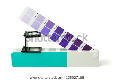 Color guide and offset print magnifier on white background - stock photo