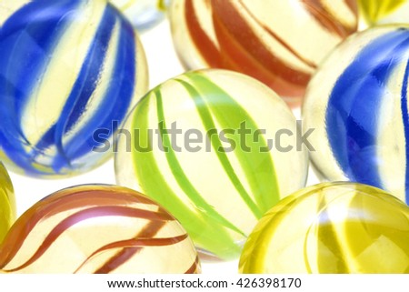 Colordul glass marbles on white background. Macro image - stock photo