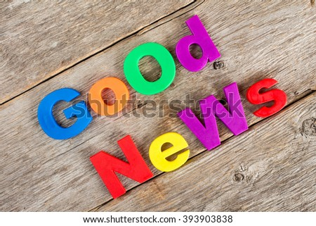 Colored  letter magnets spelling text GOOD NEWS - stock photo