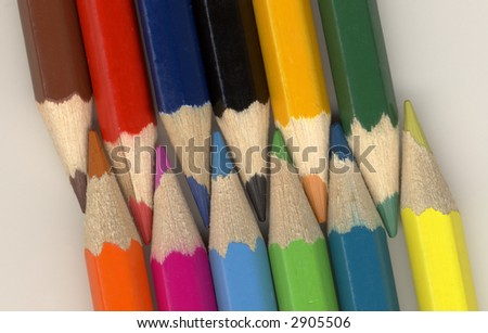 12 colored pencils against a white background color