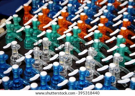 Colored removable plastic caps for soda water siphon bottles - stock photo