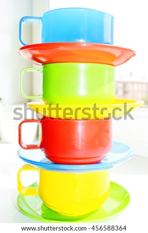 colored tableware, blue, red, yellow, green, cups