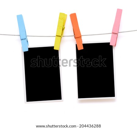 Colorful clothespin hang blank photo paper on white background - stock photo