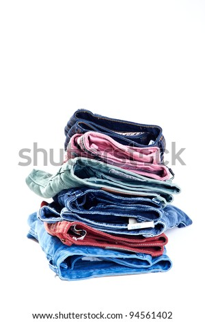 colorful denim/jeans bunch/pile - stock photo