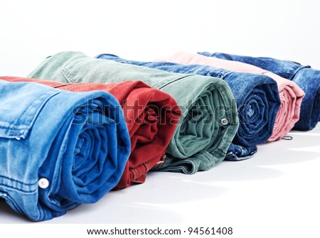 colorful denim/jeans bunch/pile rolled