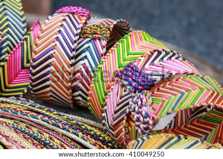 colorful dry natural grass bracelet ,Native hill tribe people handcraft and traditional pattern in Thailand - stock photo