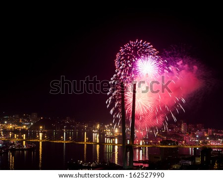 Colorful fireworks over city.  - stock photo