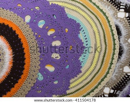 Colorful handmade knitted rugs isolated on white background