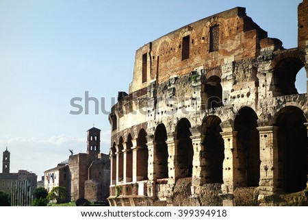 Colosseum in foreground and Imperial Forum in background              - stock photo