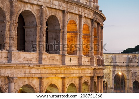Colosseum in the evening in Rome, Italy. The Colosseum is a major tourist attraction in Rome.  - stock photo